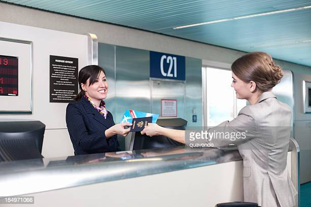 Airport Ticket Counter, Attendant Handing Customer Her Passport