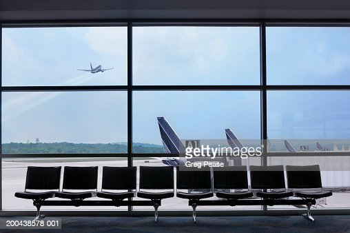 Airport waiting area, airplane taking off