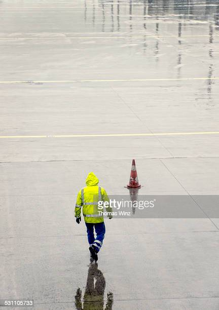 Airport worker in the rain