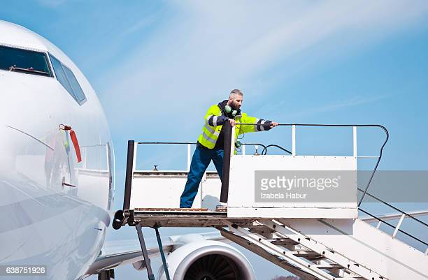 Airport worker on the aircraft stairs