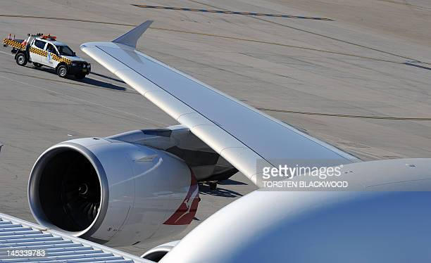 Airside security patrols near a parked Qantas Airbus A380 on the apron at Sydney International Airport on May 27 2012 Virgin announced it plans to...