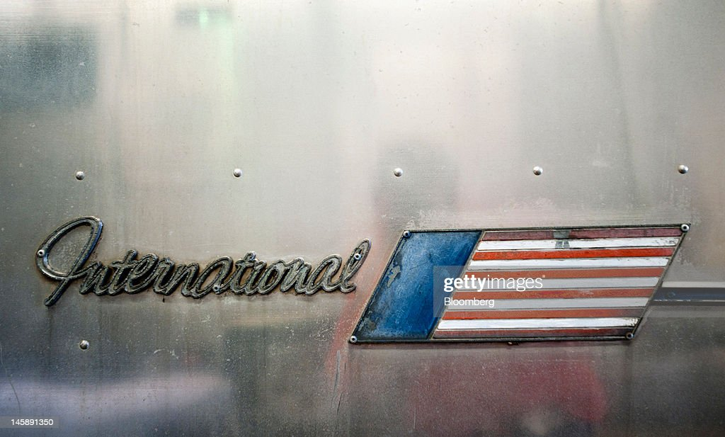 Airstream Inc. International signage is displayed on the side of a vintage trailer in the service area of the company's manufacturing facility in Jackson Center, Ohio, U.S., on Wednesday, June 6, 2012. The U.S. Federal Reserve is scheduled to release industrial production data on June 15. Photographer: Ty Wright/Bloomberg via Getty Images