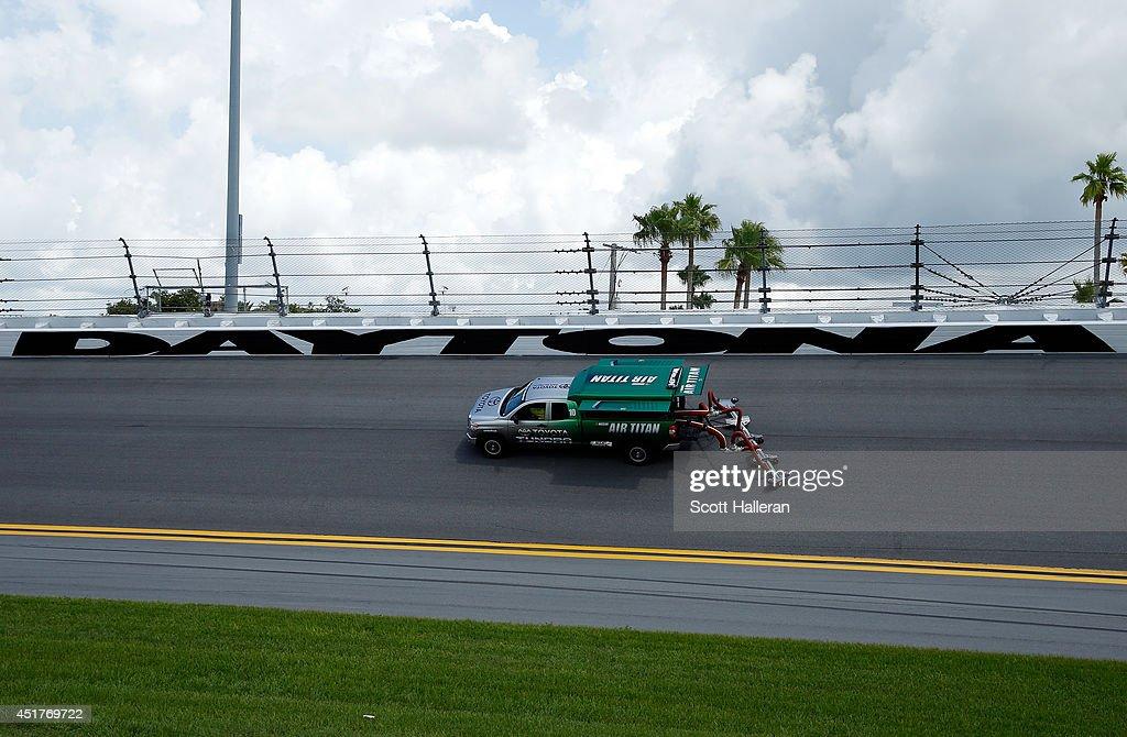 Air-Titan 2.0 track dryers run during the NASCAR Sprint Cup Series Coke Zero 400 at Daytona International Speedway on July 6, 2014 in Daytona Beach, Florida.