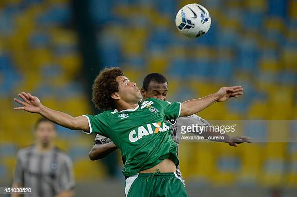 Airton of Botafogo battles for the ball with Camilo of Chapecoense during the match between Botafogo and Chapecoense as part of Brasileirao Series A...
