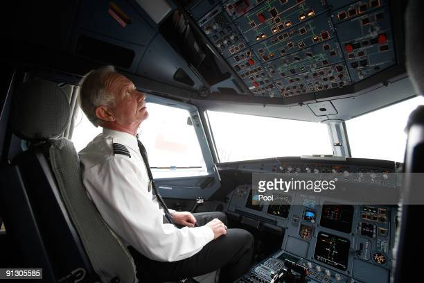 Airway pilot Captain Chesley 'Sully' Sullenberger sits in the cockpit of a US Airways flight moments before takeoff from LaGuardia Airport on his...
