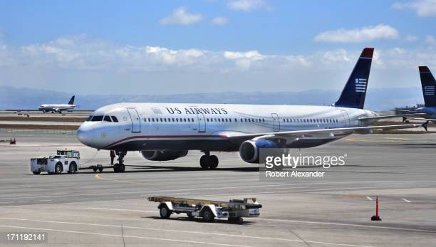 Airways Airbus A321 aircraft is towed from the gate at San Francisco International Airport in San Francisco California