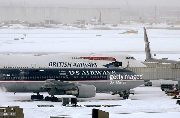 Airways and a British Airways plane sit on the tarmac at Philadelphia International Airport February 17 2003 in Philadelphia Pennsylvania All flights...