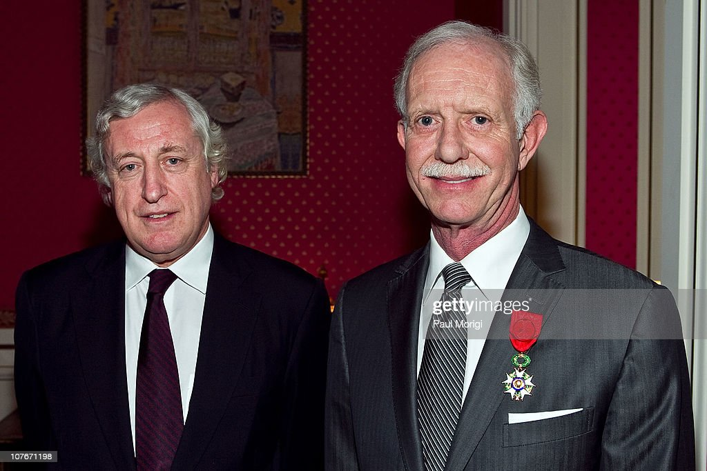 US Airways Capt. Chesley 'Sully' Sullenberger (Ret.) (R) poses for a photo with French Ambassador to the United States Pierre Vimont after being awarded the National Order of the Legion of Honour Officier Award at the French Ambassador's Residence on December 17, 2010 in Washington, DC.