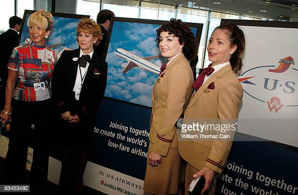 Airways flight attendants show off their retro uniforms during a news conference unveiling America West US Airways new combined look of the Airbus...
