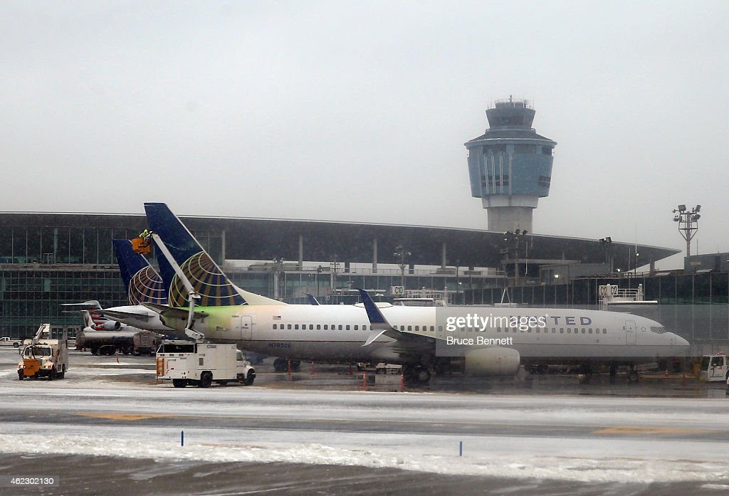 Airways jet is deiced prior to takeoff at Laguardia Airport on January 26 2015 in New York City Much of the Northeast is bracing for a major winter...