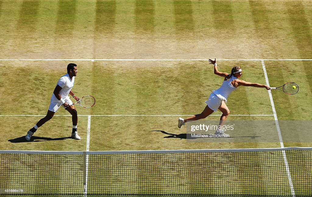 Aisam Qureshi of Pakistan and Vera Dushevina of Russia during their Mixed Doubles quarterfinal match against Naomi Broady and Neal Skupski of Great...