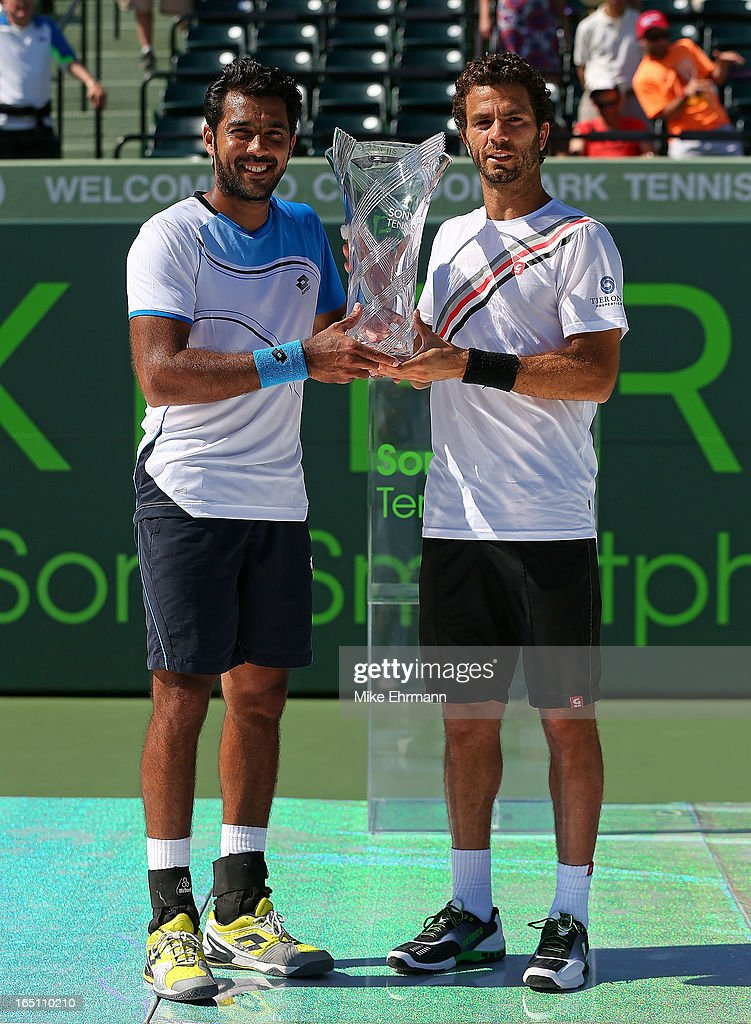 Aisam-Ul-Haq Qureshi of Pakistan and Jean-Julien Rojer of the Netherlands pose with the trophy after winning the doubles final against Mariusz Fyrstenberg and Marcin Matkowski of Poland during the Sony Open at Crandon Park Tennis Center on March 30, 2013 in Key Biscayne, Florida.