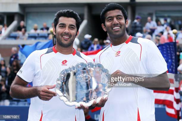 AisamUlHaq Qureshi of Pakistan and Rohan Bopanna of India hold their trophy after the men's doubles final against Bob Bryan and Mike Bryan on day...