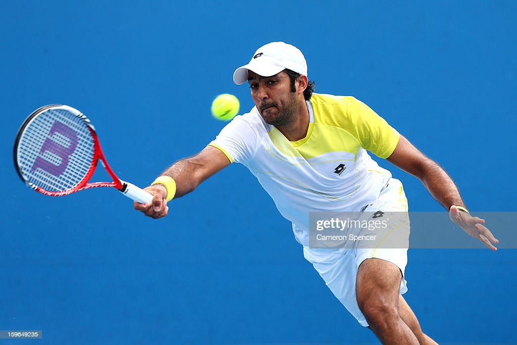 Aisam-Ul-Haq Qureshi of Pakistan plays a forehand in his second round doubles match with Jean-Julien Rojer of the Netherlands against Xavier Malisse of Belgium and Dick Norman of Belgium during day five of the 2013 Australian Open at Melbourne Park on January 18, 2013 in Melbourne, Australia.