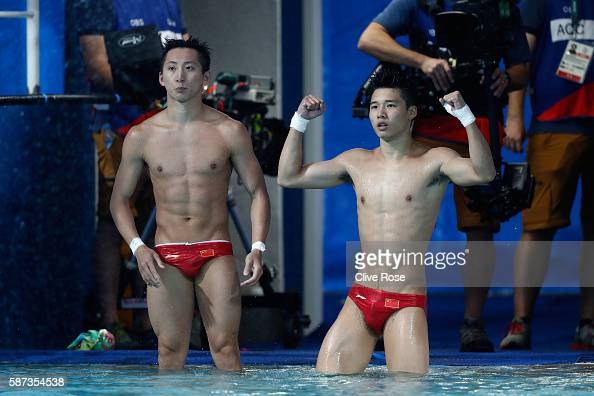 Aisen Chen and Yue Lin of China celebrate winning gold in the Men's Diving Synchronised 10m Platform Final on Day 3 of the Rio 2016 Olympic Games at...