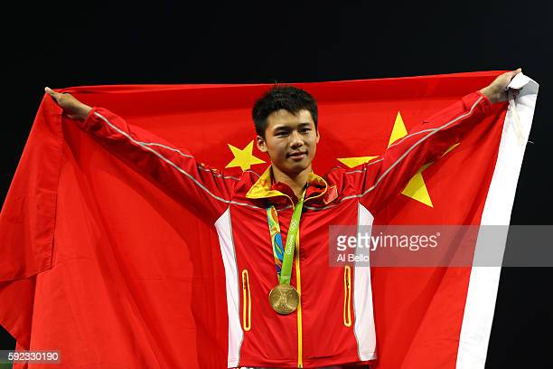 Aisen Chen of China poses with the gold medal for the Men's Diving 10m Platform on Day 15 of the Rio 2016 Olympic Games at the Maria Lenk Aquatics...