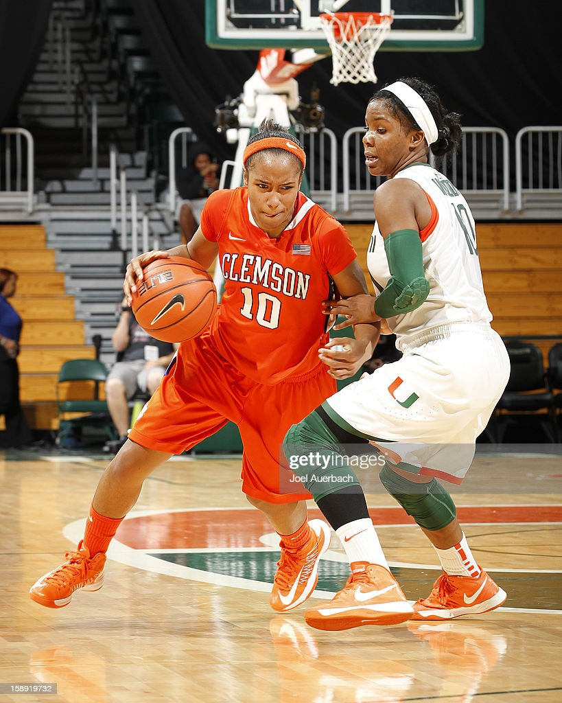 Aisha Turner #10 of the Clemson Lady Tigers dribbles the ball while being defended by Michelle Woods #10 of the Miami Hurricanes on January 3, 2013 at the BankUnited Center in Coral Gables, Florida. Miami defeated Clemson 78-56.