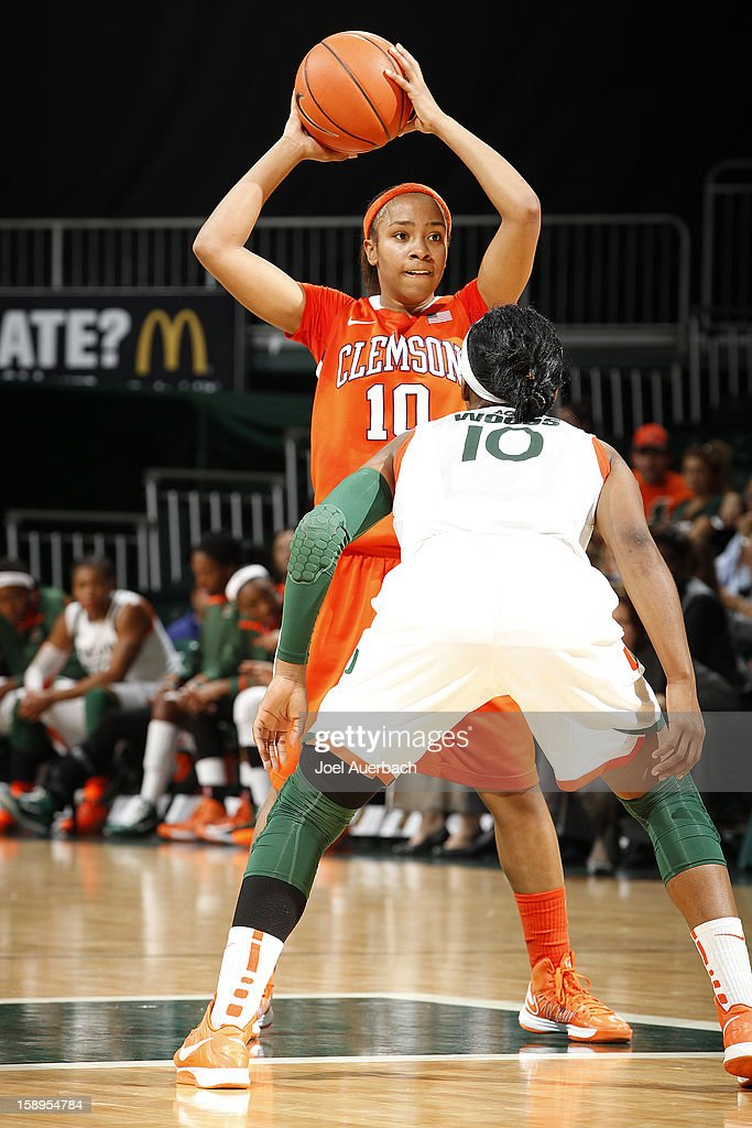 Aisha Turner #10 of the Clemson Lady Tigers looks to pass the ball past Michelle Woods #10 of the Miami Hurricanes on January 3, 2013 at the BankUnited Center in Coral Gables, Florida. Miami defeated Clemson 78-56.