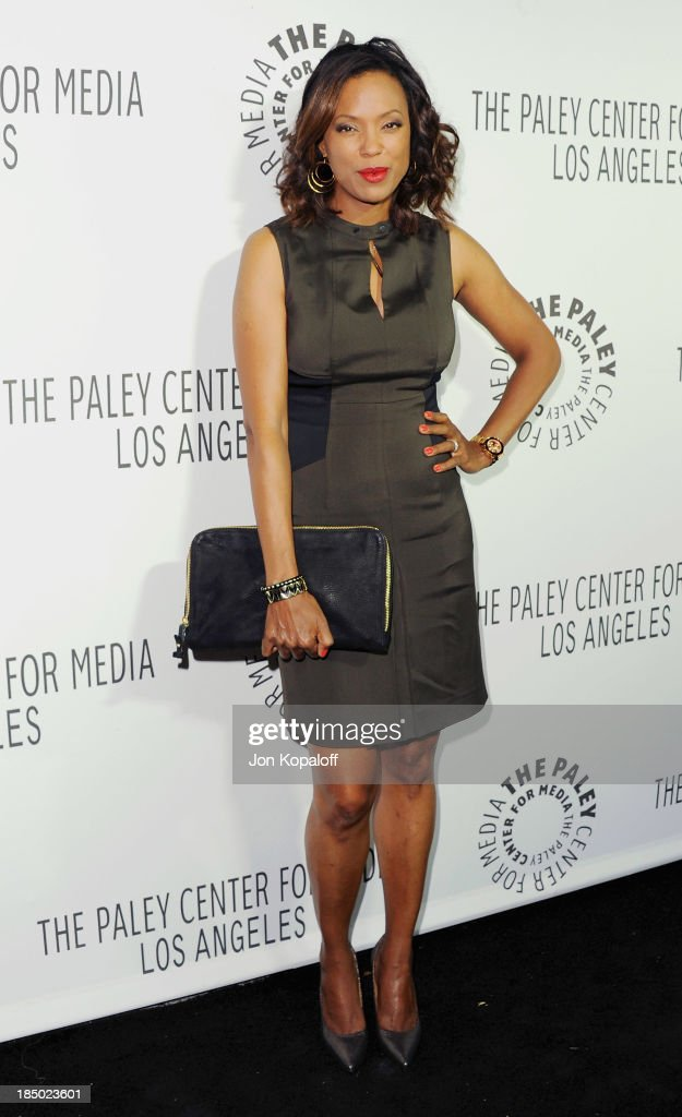 <a gi-track='captionPersonalityLinkClicked' href=/galleries/search?phrase=Aisha+Tyler&family=editorial&specificpeople=202262 ng-click='$event.stopPropagation()'>Aisha Tyler</a> arrives at The Paley Center for Media Hosts 2013 Benefit Gala Honoring FX Networks on October 16, 2013 in Los Angeles, California.