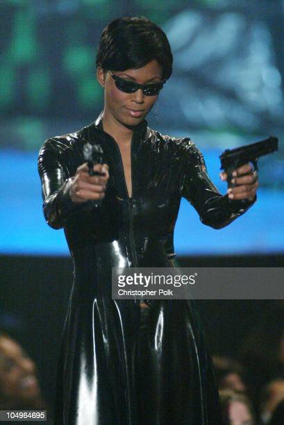 Aisha Tyler dressed as a character from the film 'The Matrix' during a segment of VH1 Big In '03 airing November 30 2003