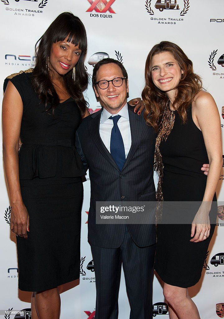 <a gi-track='captionPersonalityLinkClicked' href=/galleries/search?phrase=Aisha+Tyler&family=editorial&specificpeople=202262 ng-click='$event.stopPropagation()'>Aisha Tyler</a>, <a gi-track='captionPersonalityLinkClicked' href=/galleries/search?phrase=Rob+Schneider&family=editorial&specificpeople=206329 ng-click='$event.stopPropagation()'>Rob Schneider</a> and <a gi-track='captionPersonalityLinkClicked' href=/galleries/search?phrase=Lake+Bell&family=editorial&specificpeople=209336 ng-click='$event.stopPropagation()'>Lake Bell</a> arrive at the 14th Annual Golden Trailer Award at Saban Theatre on May 3, 2013 in Beverly Hills, California.