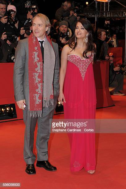 Aishwarya Rai Bachchan and Harald Zwart attend the premiere of 'The Pink Panther 2' during the 59th annual Berlin Film Festival