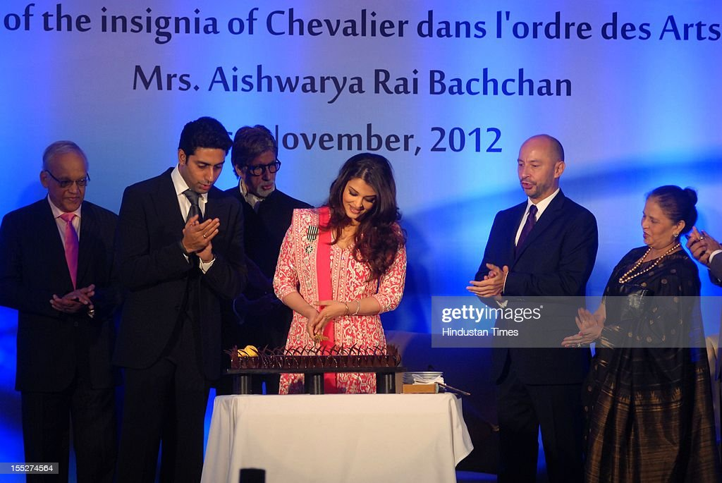 Aishwarya Rai Bachchan cutts a cake as her husband Abhishek Bachchan, father- in - law Amitabh Bachchan, father Krishna Rai, mother Brindya Rai and French ambassador to India Francois Richier look on during a function to confer her with French Knight of the Order of Arts and Letters for her contribution to the arts on November 1, 2012 in Mumbai, India. She also celebrated also celebrated her 39th birthday.