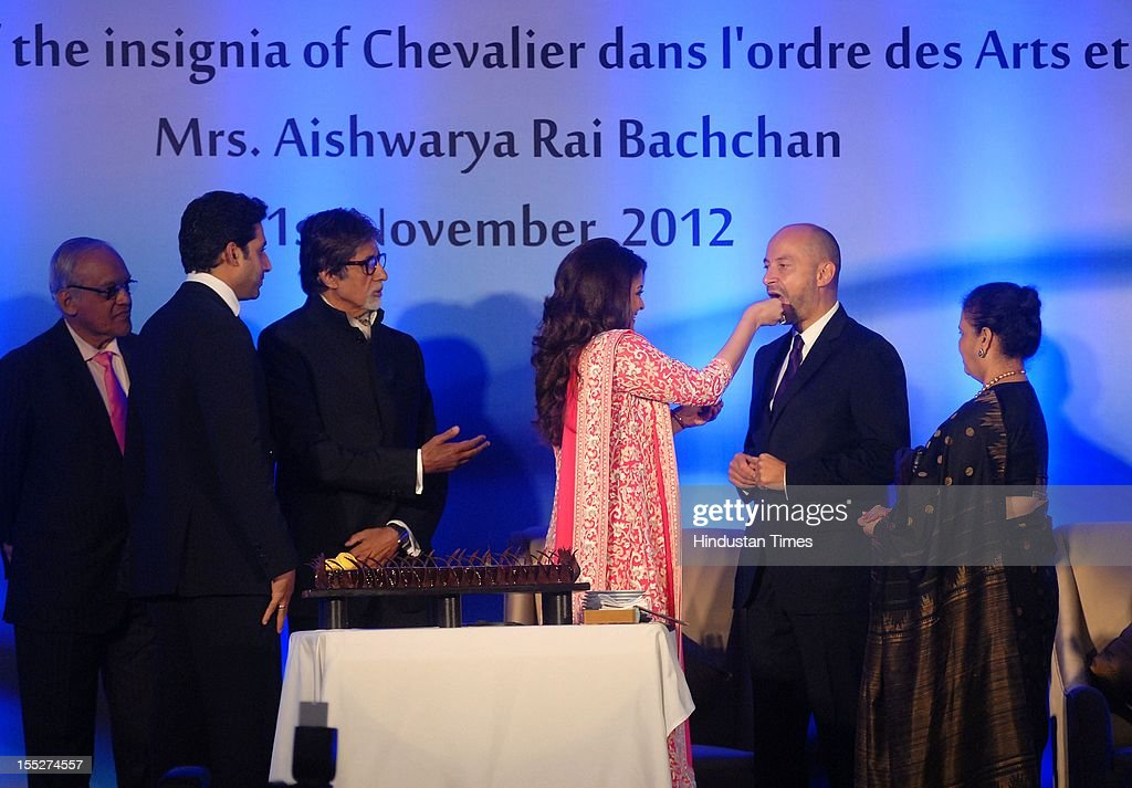 Aishwarya Rai Bachchan feeds cake to French ambassador to India Francois Richier as her husband Abhishek Bachchan, father- in - law Amitabh Bachchan, father Krishna Rai and mother Brindya Rai look on during a function to confer her with French Knight of the Order of Arts and Letters for her contribution to the arts on November 1, 2012 in Mumbai, India. She also celebrated also celebrated her 39th birthday.