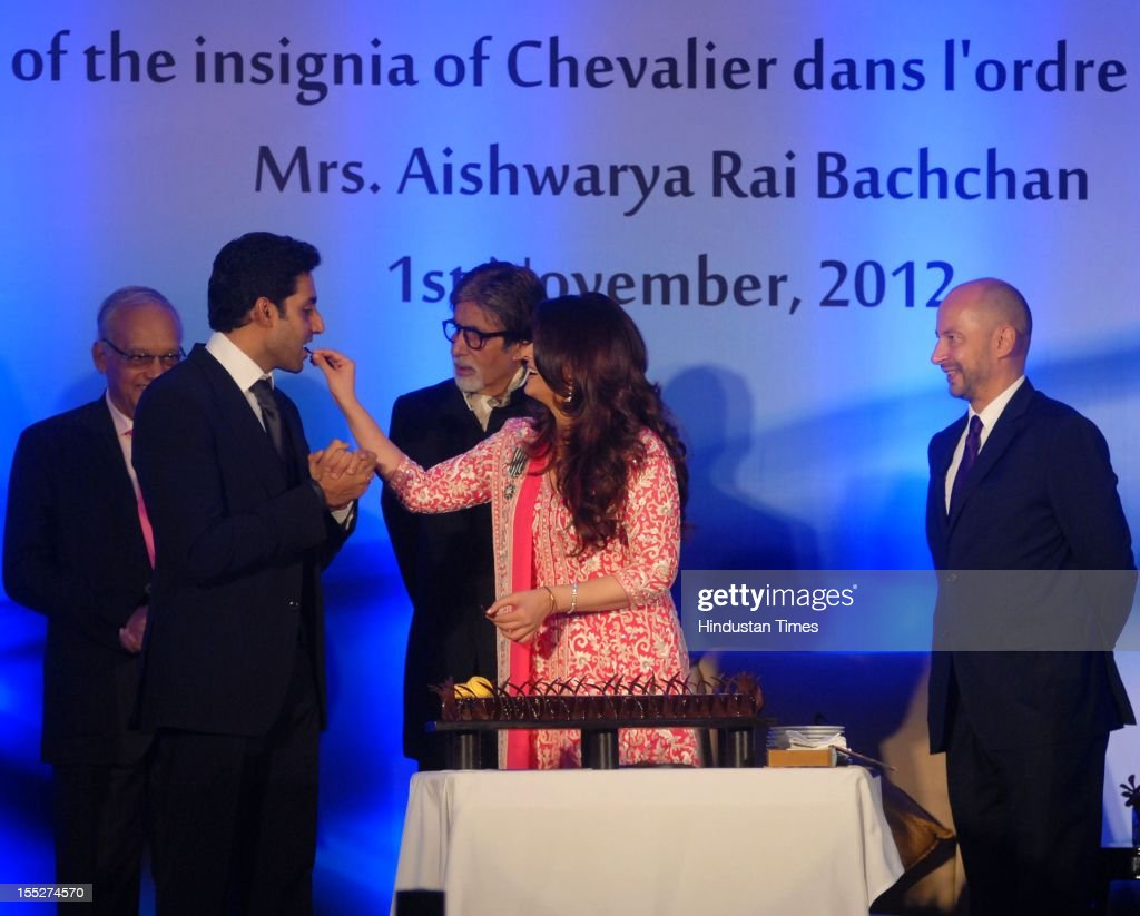 <a gi-track='captionPersonalityLinkClicked' href=/galleries/search?phrase=Aishwarya+Rai&family=editorial&specificpeople=202237 ng-click='$event.stopPropagation()'>Aishwarya Rai</a> Bachchan feeds cake to her husband <a gi-track='captionPersonalityLinkClicked' href=/galleries/search?phrase=Abhishek+Bachchan&family=editorial&specificpeople=549431 ng-click='$event.stopPropagation()'>Abhishek Bachchan</a> during a function to confer her with French Knight of the Order of Arts and Letters for her contribution to the arts on November 1, 2012 in Mumbai, India. She also celebrated also celebrated her 39th birthday.