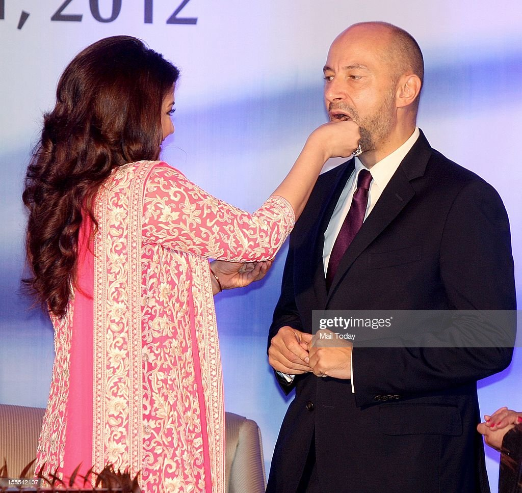 Aishwarya Rai Bachchan offers a piece of cake to French Ambassador to India, Francois Richier at a function where she was conferred with the French civilian award, Officer Dan Ordre Arts et des Lettres in Mumbai on Thursday.