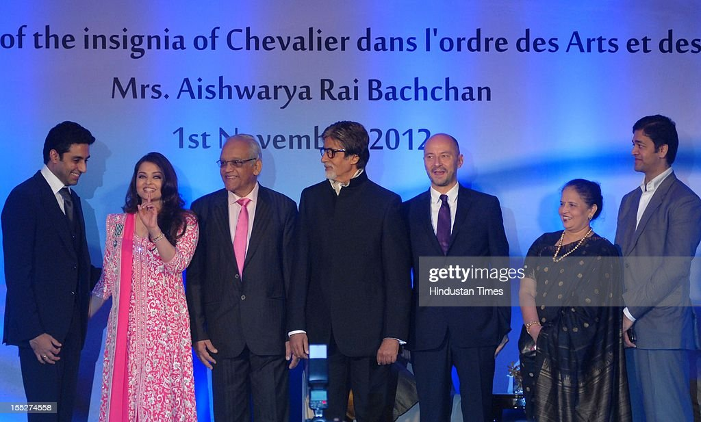 <a gi-track='captionPersonalityLinkClicked' href=/galleries/search?phrase=Aishwarya+Rai&family=editorial&specificpeople=202237 ng-click='$event.stopPropagation()'>Aishwarya Rai</a> Bachchan on stage with her husband <a gi-track='captionPersonalityLinkClicked' href=/galleries/search?phrase=Abhishek+Bachchan&family=editorial&specificpeople=549431 ng-click='$event.stopPropagation()'>Abhishek Bachchan</a> (L), father-in-law <a gi-track='captionPersonalityLinkClicked' href=/galleries/search?phrase=Amitabh+Bachchan&family=editorial&specificpeople=220394 ng-click='$event.stopPropagation()'>Amitabh Bachchan</a> (C), father Krishna Rai (3rd,R), mother Brindya Rai (2nd,L), brother Aditya Rai (R) and French ambassador to India Francois Richier (3rd,L) during a function to confer her with French Knight of the Order of Arts and Letters for her contribution to the arts on November 1, 2012 in Mumbai, India. She also celebrated also celebrated her 39th birthday.