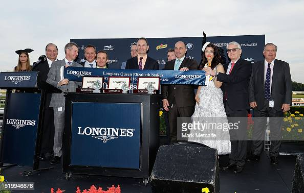 Aishwarya Rai Bachchan poses with the Longines Queen Elizabeth Stakes winning connections of Lucia Valentina during Queen Elizabeth Stakes Day at...