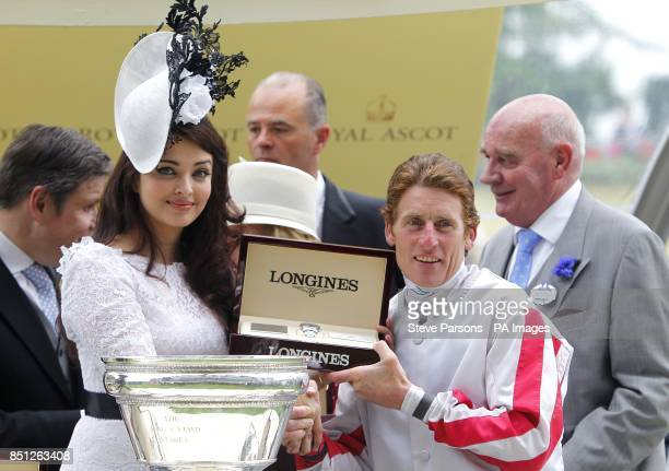 Aishwarya Rai Bachchan presents the King's Stand Stakes trophy to jockey Johnny Murtagh during day one of the Royal Ascot meeting at Ascot Racecourse...