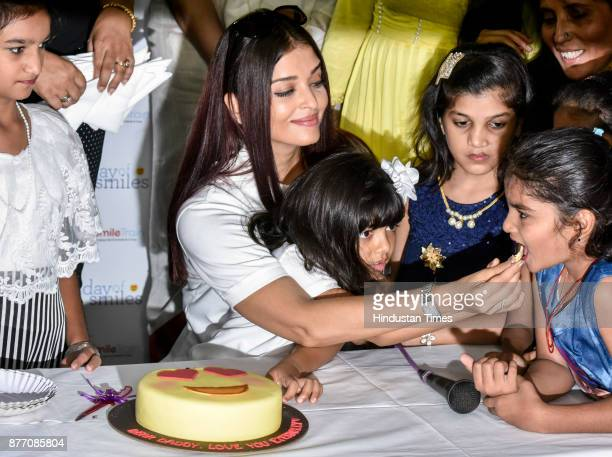Aishwarya Rai Bachchan with her daughter Aaradhya and NGO Smile Train during unveils Day of Smiles in the memory of her father on his birthday at...