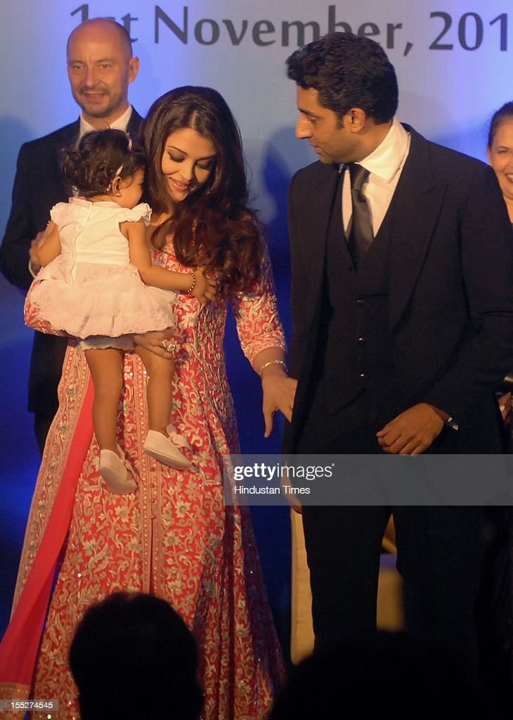 Aishwarya Rai Bachchan with her daughter Aradhya and husband Abhishek Bachchan during a function to confer her with French Knight of the Order of Arts and Letters for her contribution to the arts on November 1, 2012 in Mumbai, India. She also celebrated also celebrated her 39th birthday.
