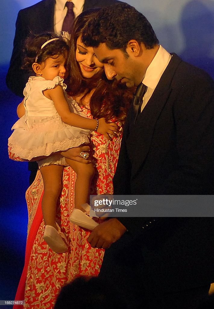 <a gi-track='captionPersonalityLinkClicked' href=/galleries/search?phrase=Aishwarya+Rai&family=editorial&specificpeople=202237 ng-click='$event.stopPropagation()'>Aishwarya Rai</a> Bachchan with her daughter Aradhya and husband <a gi-track='captionPersonalityLinkClicked' href=/galleries/search?phrase=Abhishek+Bachchan&family=editorial&specificpeople=549431 ng-click='$event.stopPropagation()'>Abhishek Bachchan</a> during a function to confer her with French Knight of the Order of Arts and Letters for her contribution to the arts on November 1, 2012 in Mumbai, India. She also celebrated also celebrated her 39th birthday.