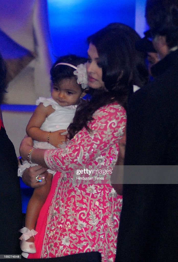 Aishwarya Rai Bachchan with her daughter Aradhya during a function to confer her with French Knight of the Order of Arts and Letters for her contribution to the arts on November 1, 2012 in Mumbai, India. She also celebrated also celebrated her 39th birthday.
