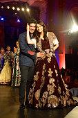 Aishwarya RaiBachchan and designer Manish Malhotra walk the runway at the Fashion Design Council of India's Amazon India Couture Week 2015's finale...