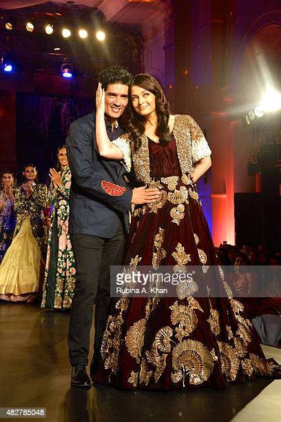 Aishwarya RaiBachchan and designer Manish Malhotra walk the runway at the Fashion Design Council of India's Amazon India Couture Week 2015's finale...