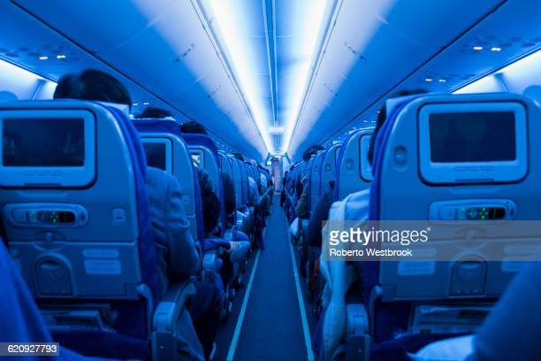 Aisle in full airplane