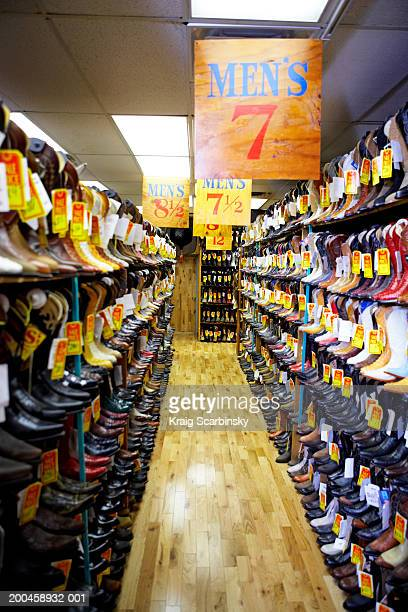 Aisle lined with cowboy boots in shoe store