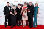 Aisling Walsh Kate Triggs Amanda Coe and Paul Fritt winners of the Best MiniSeries award for Room At The Top with presenters Warren Brown and Lesley...