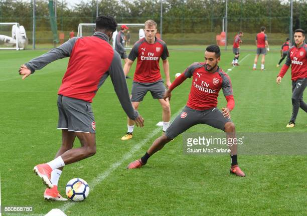 Aisnley MaitlandNiles and Theo Walcott of Arsenal during a training session at London Colney on October 13 2017 in St Albans England