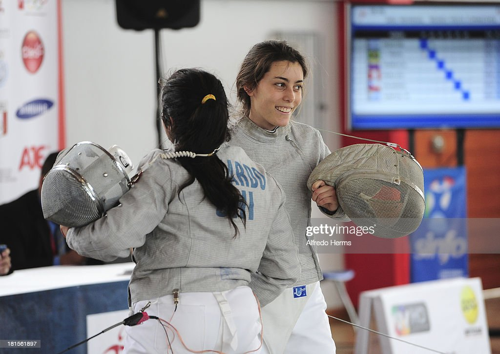 Aissa Francesca Puelles of Peru is congratulated by Josefa Fajardo of Chile after the Women´s Individual Foil competition as part of the IODESUR South American Youth Games at Gimnasio Villa Deportiva del Callao on September 22, 2013 in Lima, Peru.
