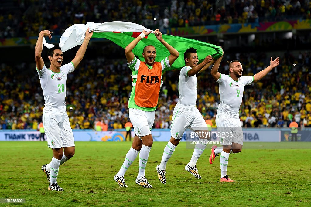 Aissa Mandi (1st L) and players of Algeria celebrate qualifying for the knock out stage after the 1-1 draw in the 2014 FIFA World Cup Brazil Group H match between Algeria and Russia at Arena da Baixada on June 26, 2014 in Curitiba, Brazil.