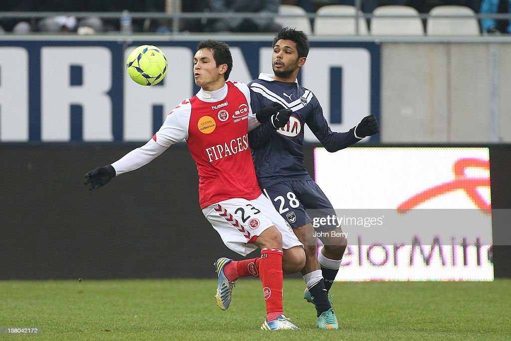 Aissa Mandi of Reims and Benoit Tremoulinas of Bordeaux fight for the ball during the French Ligue 1 match between Stade de Reims and Girondins de Bordeaux at the Stade Auguste Delaune on December 9, 2012 in Reims, France.