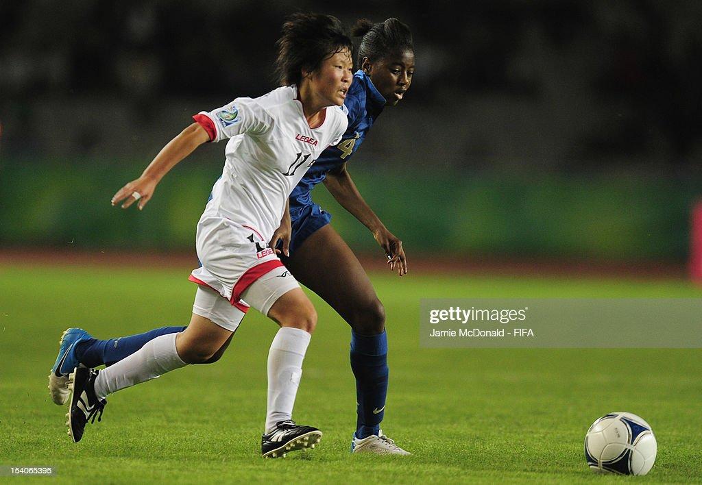 Aissatou Tounkara of France battles with Phyong Hwa Kim of Korea DPR during the FIFA U-17 Women's World Cup 2012 Final match beween France and Korea DPR at Tofig Bahramov Stadium on October 13, 2012 in Baku, Azerbaijan.