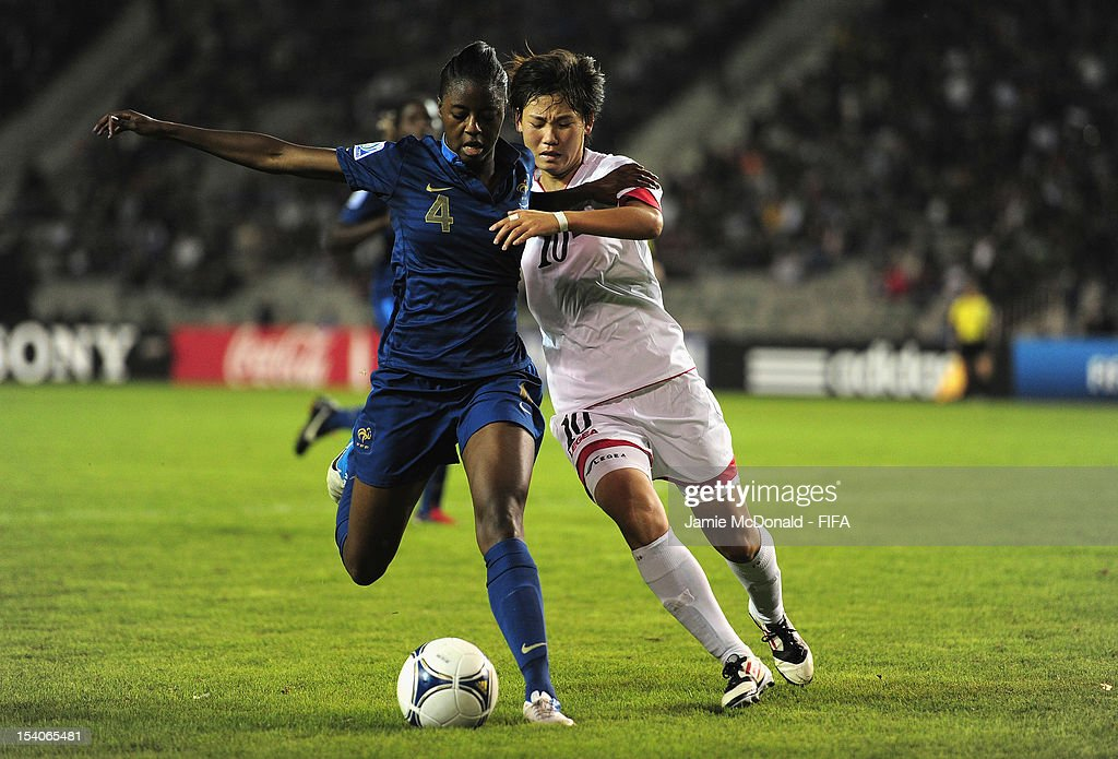 Aissatou Tounkara of France battles with Un Sim Ri of Korea DPR during the FIFA U-17 Women's World Cup 2012 Final match beween France and Korea DPR at Tofig Bahramov Stadium on October 13, 2012 in Baku, Azerbaijan.
