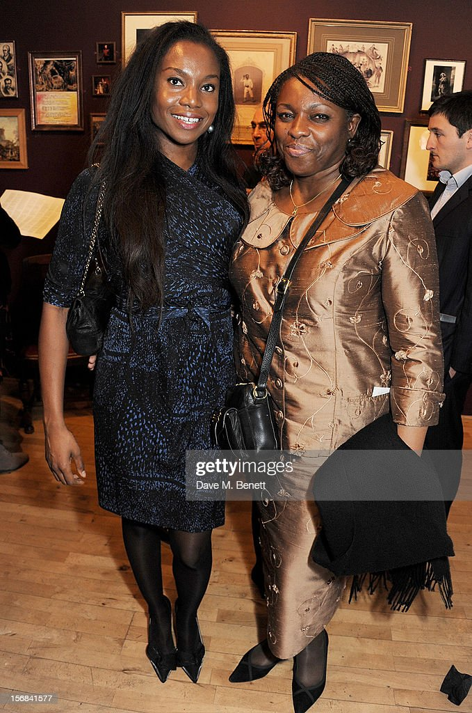 Aita Ighodaro (L) and Claire Ighodaro attend Tricycle Theatre's 'Red Velvet: The Director's Party' on November 22, 2012 in London, England.