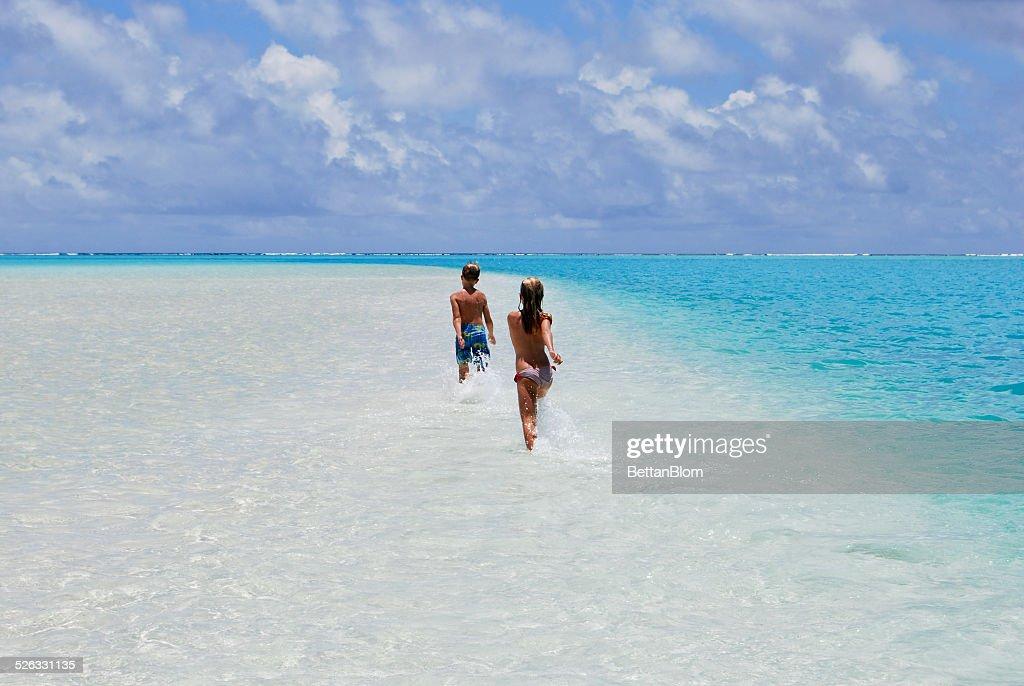 Aitutaki, Children running in sea
